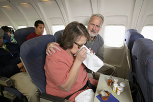 woman-sick-on-plane
