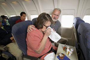 woman-sick-on-plane