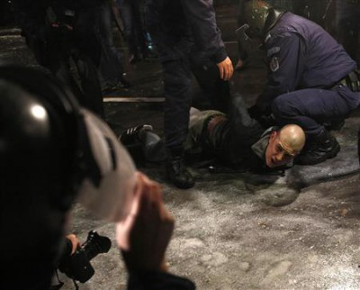 A man is detained by police during a protest against high electricity prices in Sofia