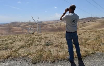 "Doug Bell, wildlife program manager for East Bay Regional Park District, looks for golden eagles from the mothballed Tres Vaqueros wind farm in the Altamont area of Contra Costa County, Calif., on Friday, May 8, 2015. Questions remain regarding many birds are killed on the Altamont Pass by the wind turbines. The number of estimated deaths due to the turbines ranges from zero to about 6,000 per year. This includes birds of all species including golden eagles. A new ""background mortality"" study, which will come up with estimates on how many birds in the area might be dying from causes other than the turbines, will be released soon. (Dan Honda/Bay Area News Group)"