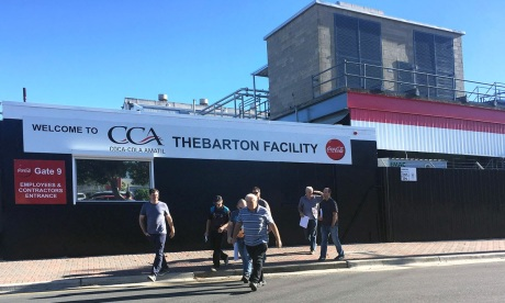 Workers outside the Coca Cola Amatil plant at Thebarton this morning